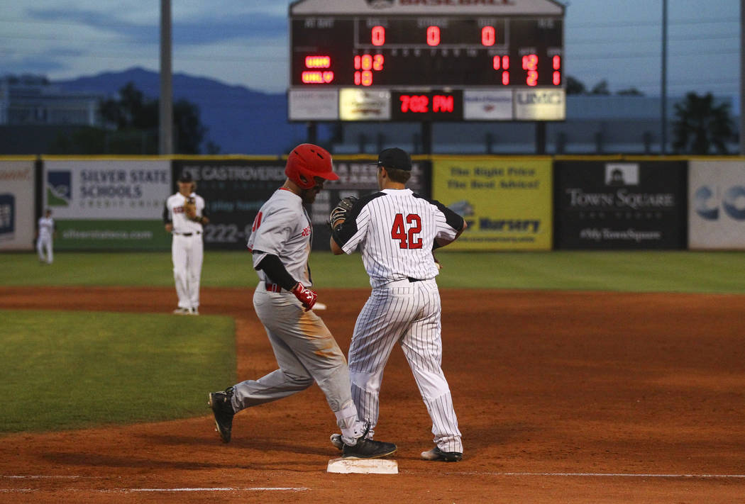 New Mexico infielder Jack Zoellner (28) gets tagged out by UNLV infielder Nick Ames (42) at first base during a baseball game at Wilson Stadium in Las Vegas on Friday, March 24, 2017. (Chase Steve ...