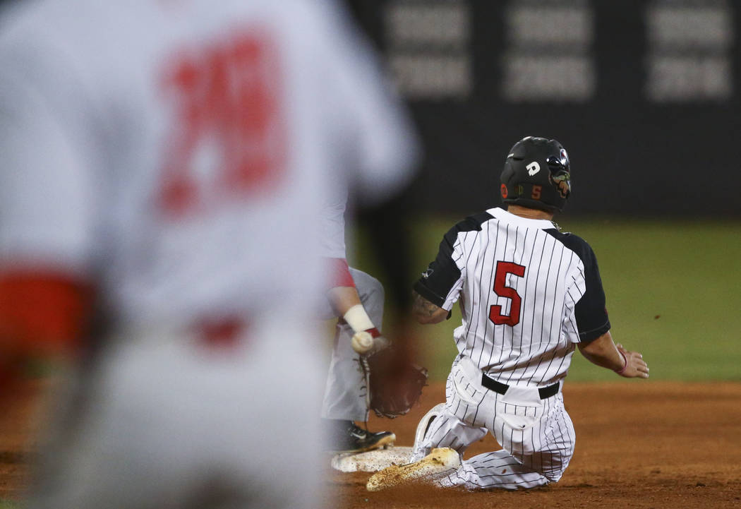 UNLV infielder Kyle Isbel (5) makes it to second base against New Mexico infielder Andre Gregory (9) during a baseball game at Wilson Stadium in Las Vegas on Friday, March 24, 2017. (Chase Stevens ...
