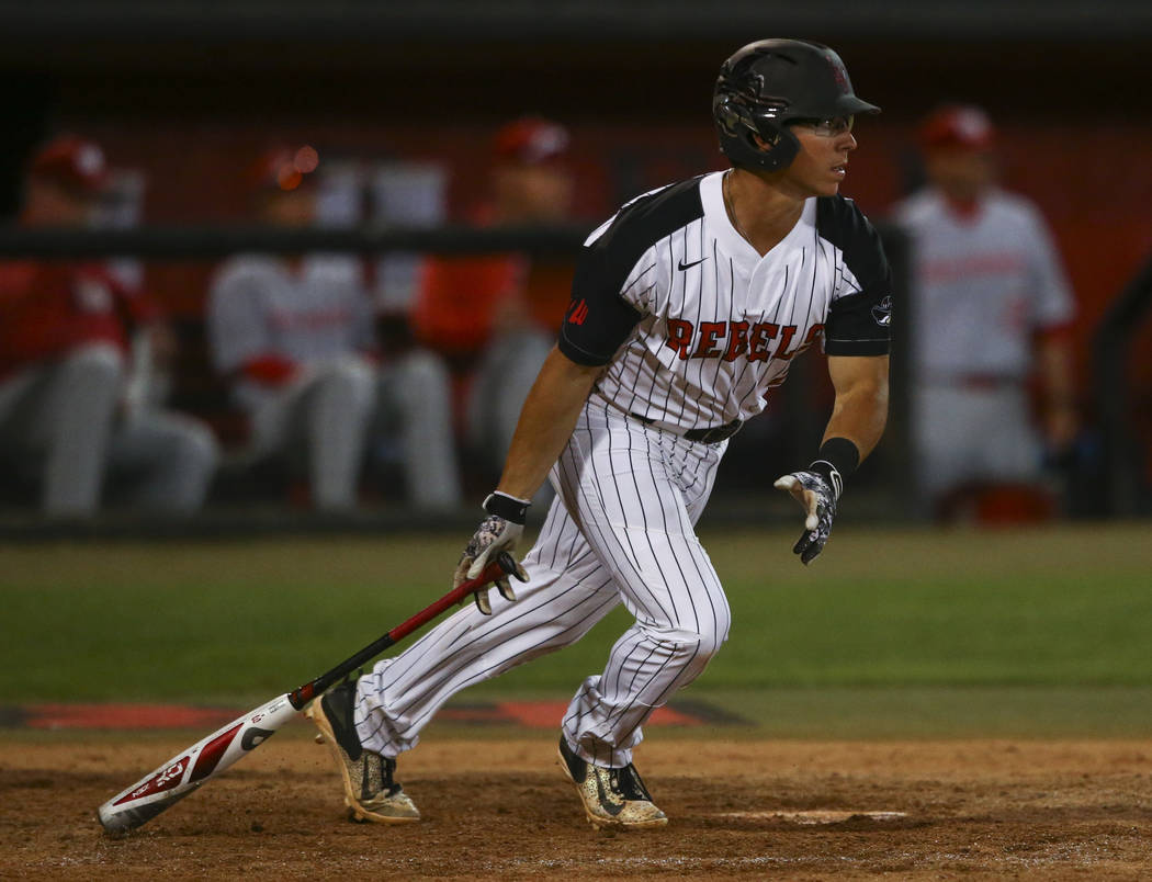 UNLV infielder Justin Jones (2) hits a single against New Mexico during a baseball game at Wilson Stadium in Las Vegas on Friday, March 24, 2017. (Chase Stevens/Las Vegas Review-Journal) @cssteven ...