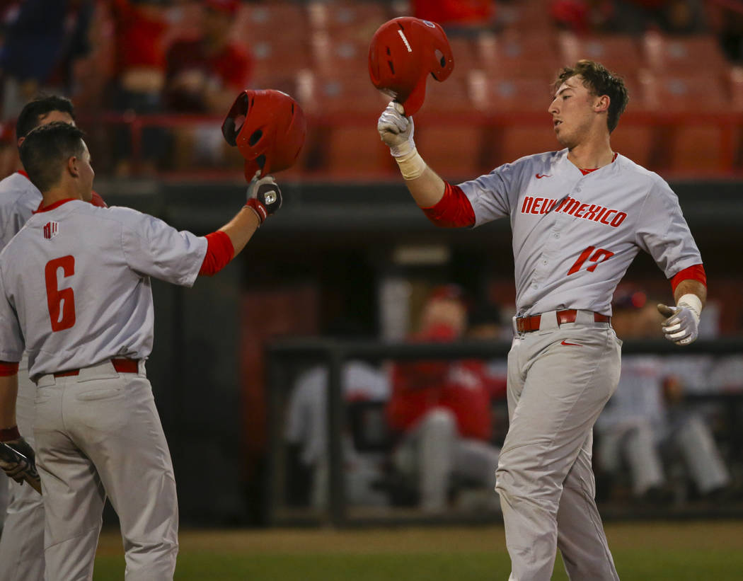 New Mexico catcher Daniel Herrera (17) celebrates his home run with New Mexico infielder Beau Capanna (6) during a baseball game at Wilson Stadium in Las Vegas on Friday, March 24, 2017. (Chase St ...