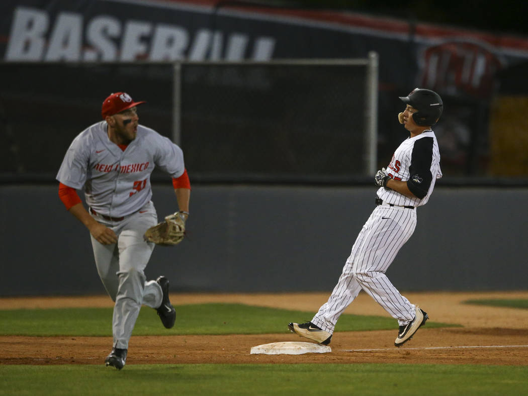 UNLV outfielder Ernie De La Trinidad (25) makes it to third base against New Mexico infielder Carl Stajduhar (30) during a baseball game at Wilson Stadium in Las Vegas on Friday, March 24, 2017. ( ...
