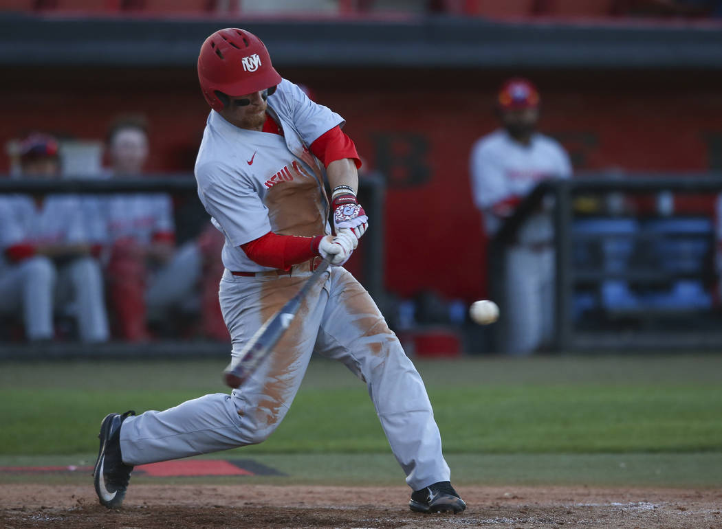New Mexico outfielder Jared Mang (15) swings at a pitch from UNLV's Alan Strong (16) during a baseball game at Wilson Stadium in Las Vegas on Friday, March 24, 2017. (Chase Stevens/Las Vegas Revie ...