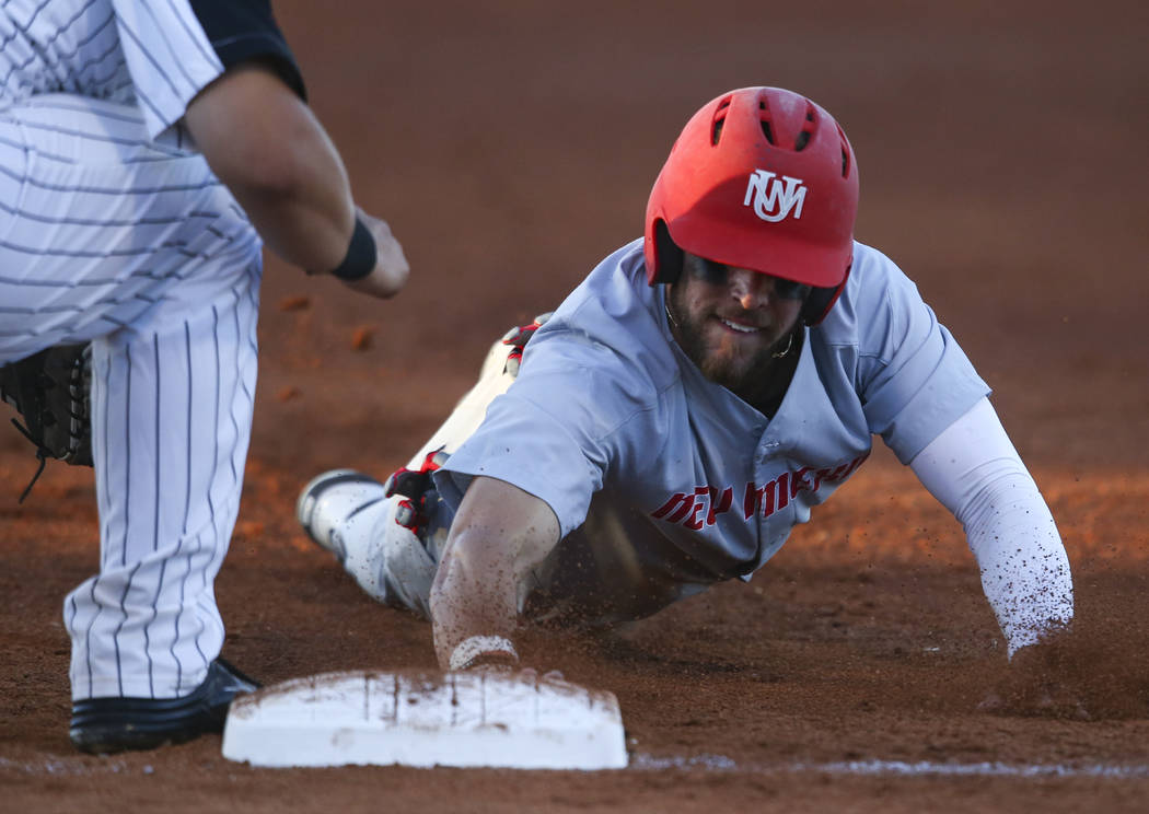 New Mexico outfielder Luis Gonzalez (27) returns to first base to avoid getting picked off by UNLV during a baseball game at Wilson Stadium in Las Vegas on Friday, March 24, 2017. (Chase Stevens/L ...