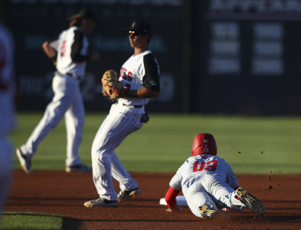 New Mexico outfielder Danny Collier (43) slides into second base against UNLV during a baseball game at Wilson Stadium in Las Vegas on Friday, March 24, 2017. (Chase Stevens/Las Vegas Review-Journ ...