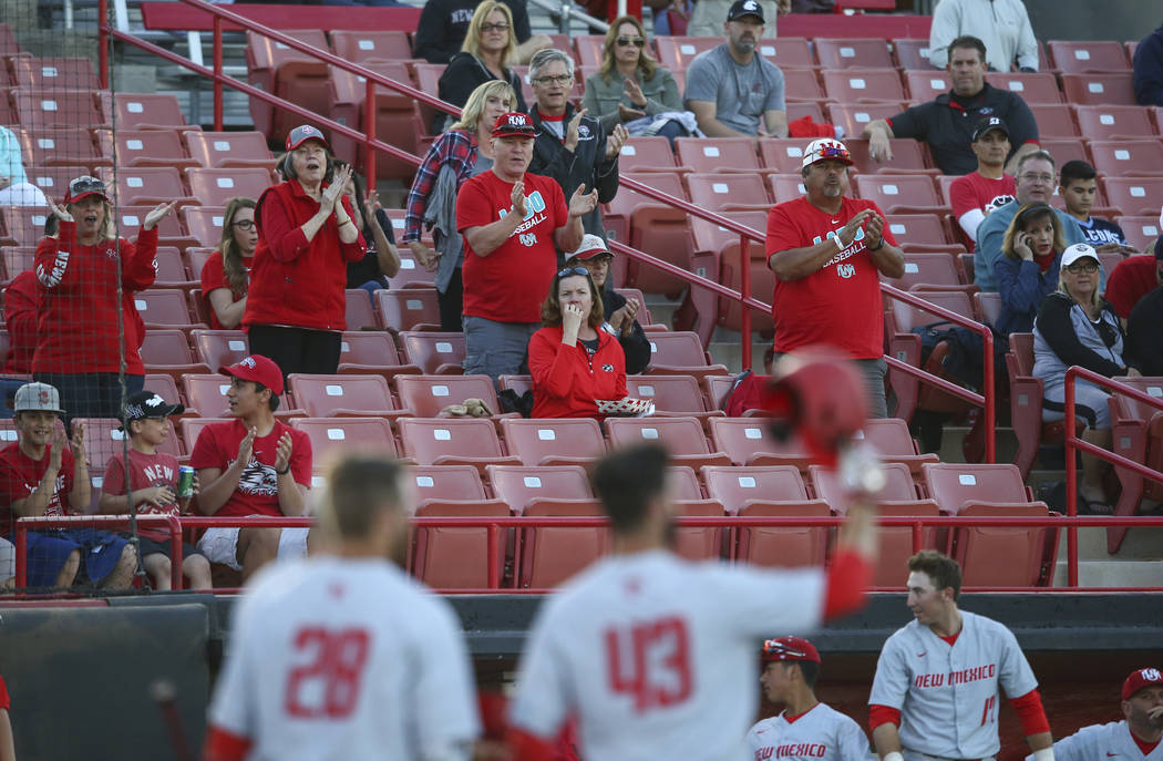 New Mexico fans celebrate as their team plays UNLV during a baseball game at Wilson Stadium in Las Vegas on Friday, March 24, 2017. (Chase Stevens/Las Vegas Review-Journal) @csstevensphoto