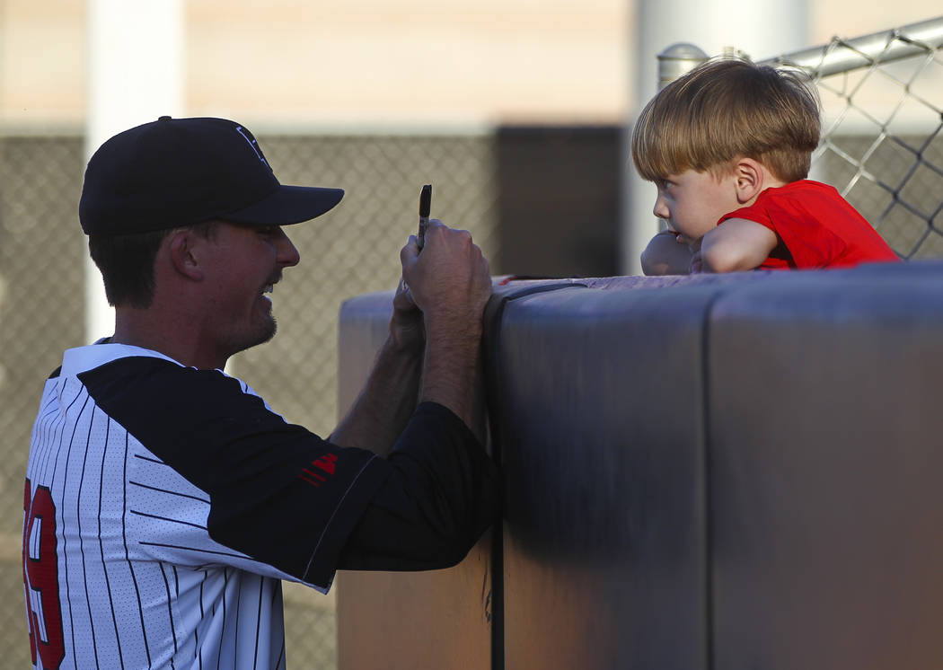 UNLV pitcher Connor Clark (39) signs a ball for Benjamin Hughe, 4, before a baseball game against New Mexico at Wilson Stadium in Las Vegas on Friday, March 24, 2017. (Chase Stevens/Las Vegas Revi ...