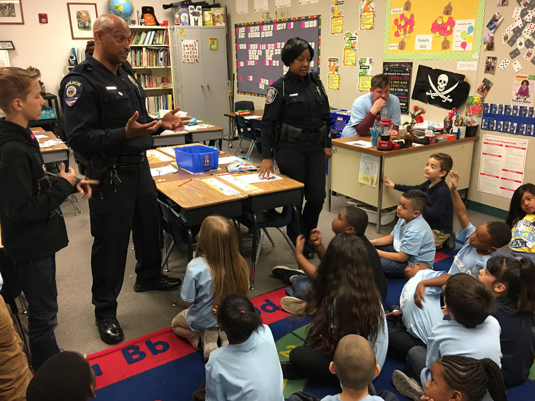 Clark County School District and North Las Vegas police officers speak to a first grade class at Raul P. Elizondo Elementary School in North Las Vegas, Wednesday, March 8, 2017. North Las Vegas fa ...