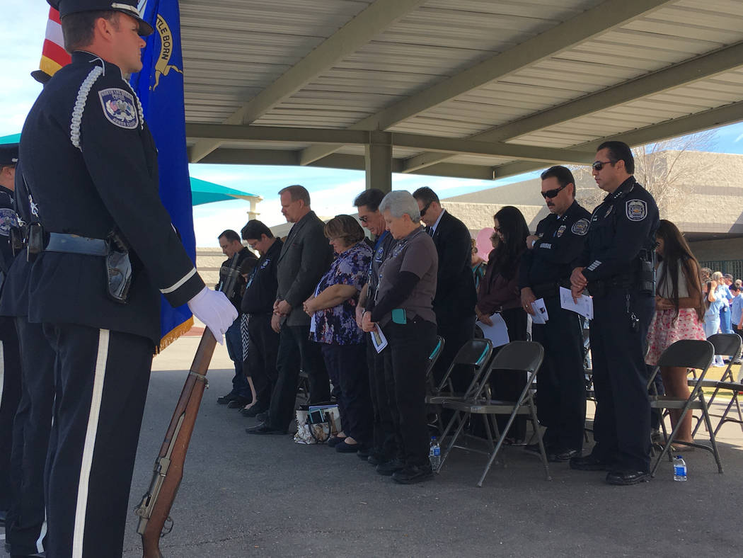 Opening prayer at the vigil for North Las Vegas fallen officer  Raul P. Elizondo at Raul P. Elizondo Elementary School in North Las Vegas, Wednesday, March 8, 2017. Officer Elizondo was shot and k ...