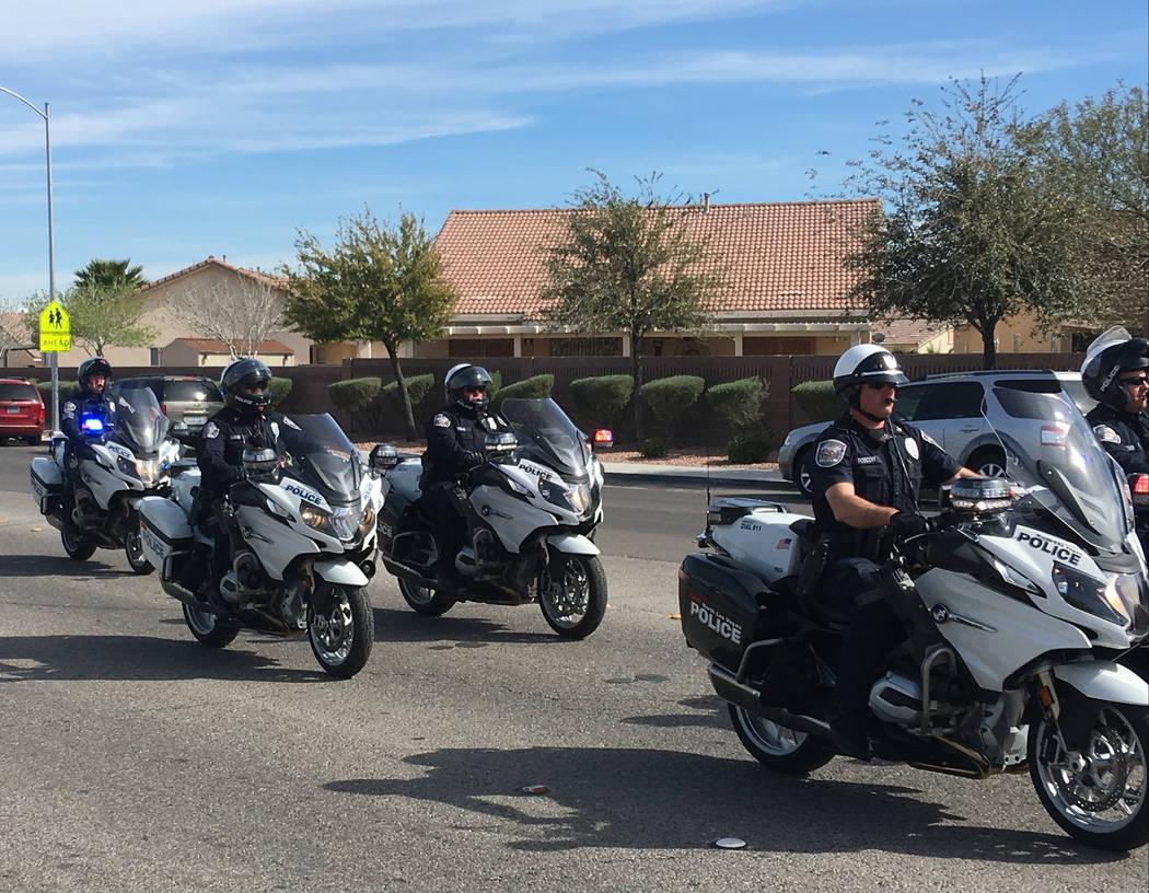 North Las Vegas patrol participates in a parade in memory of North Las Vegas fallen officer Raul P. Elizondo in North Las Vegas, Wednesday, March 8, 2017. Officer Elizondo was shot and killed in 1 ...