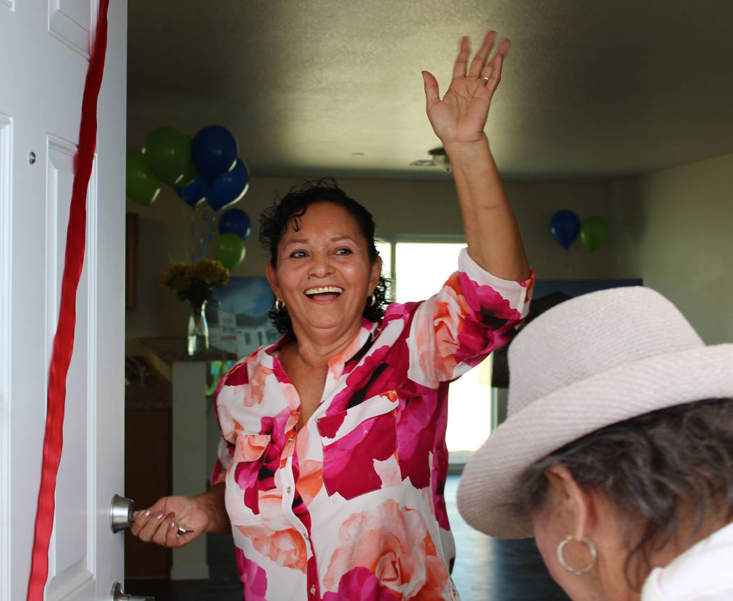 Ana Rosas-Hernandez waves as she steps into her new home in Henderson on Thursday, March 9, 2017. Hernandez's home is the latest single-family home project by Habitat for Humanity in Henderson. (G ...