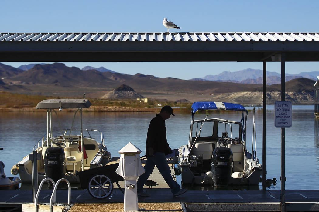 A man is silhouetted against the water at Las Vegas Boat Harbor at Lake Mead National Recreation Area on Tuesday, Feb. 14, 2017. Chase Stevens/Las Vegas Review-Journal) @csstevensphoto