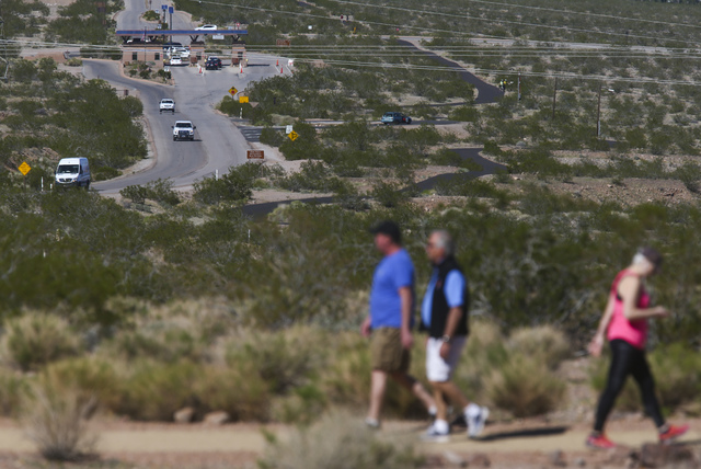 Vehicles come and go from the entrance station, upper left, as people hike along the Historic Railroad Trail at Lake Mead National Recreation Area on Tuesday, Feb. 14, 2017. (Chase Stevens/Las Veg ...