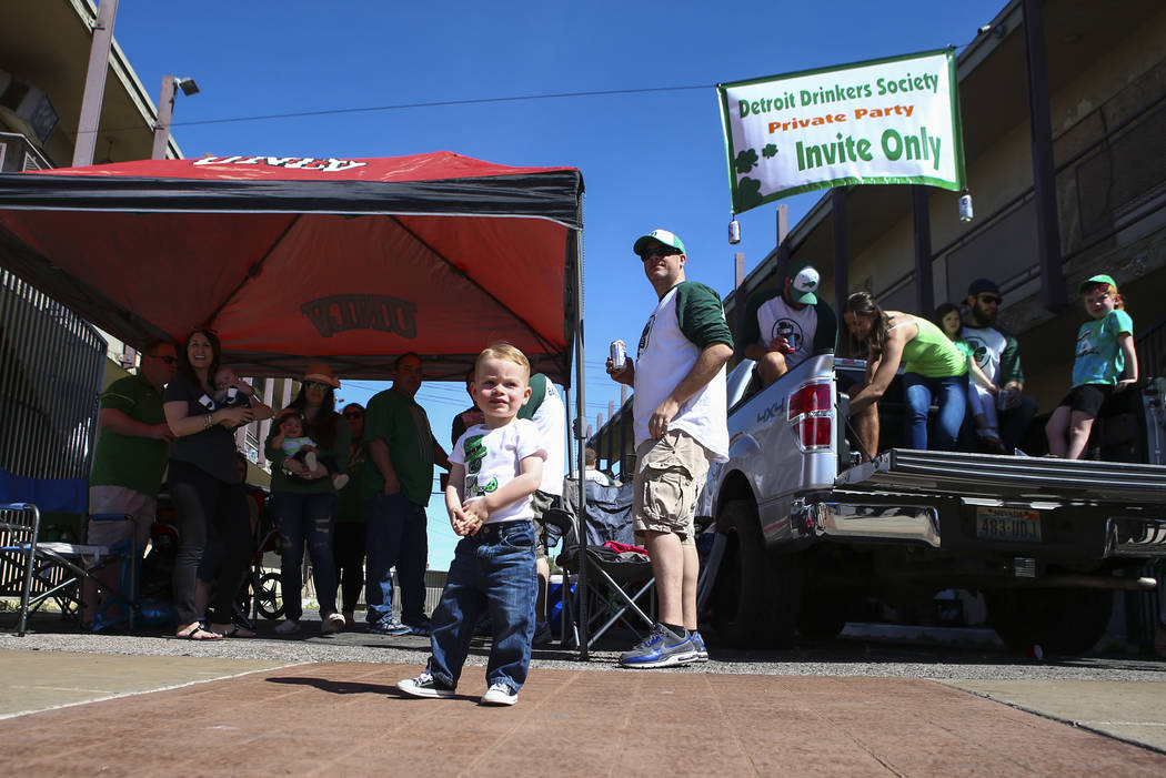 Two-year-old Landon Fandel takes in the sights of the St. Patrick's Day parade along with the Detroit Drinkers Society in Henderson on Saturday, March 11, 2017. (Chase Stevens/Las Vegas Review-Jou ...