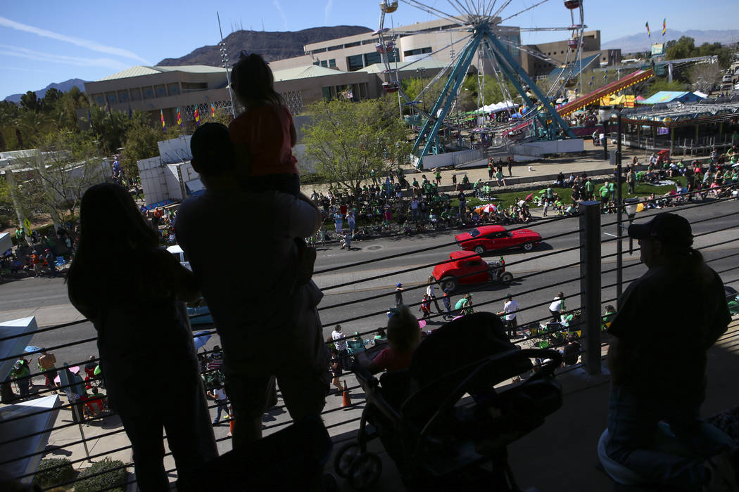 People watch from a parking garage as classic cars drive down Water Street during the St. Patrick's Day parade in Henderson on Saturday, March 11, 2017. (Chase Stevens/Las Vegas Review-Journal) @c ...