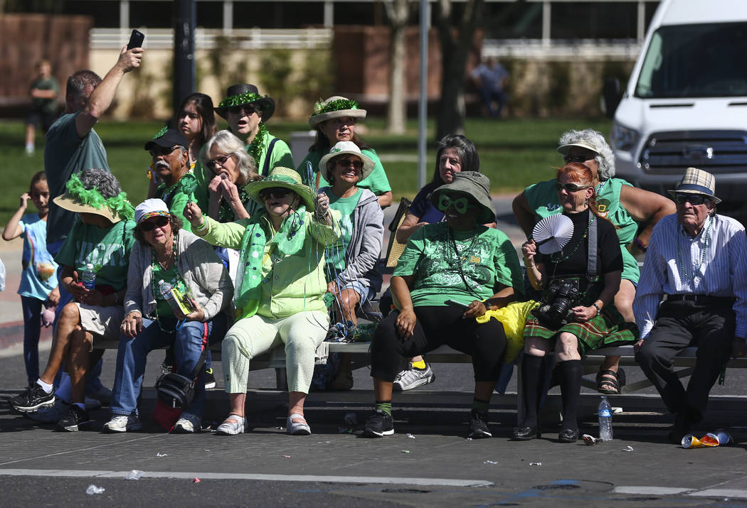 Attendees watch parade participants pass by during the St. Patrick's Day parade in Henderson on Saturday, March 11, 2017. (Chase Stevens/Las Vegas Review-Journal) @csstevensphoto