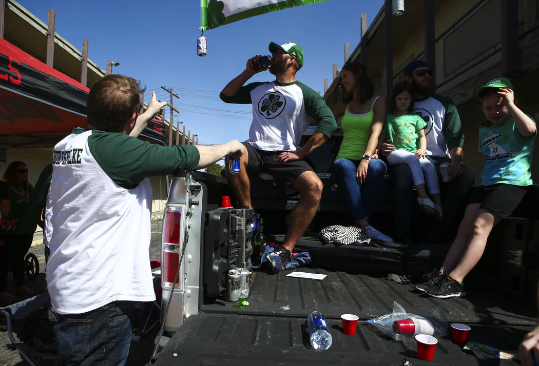 Doug, who declined to give his last name, second from left, enjoys a beer with the Detroit Drinkers Society during the St. Patrick's Day parade in Henderson on Saturday, March 11, 2017. (Chase Ste ...