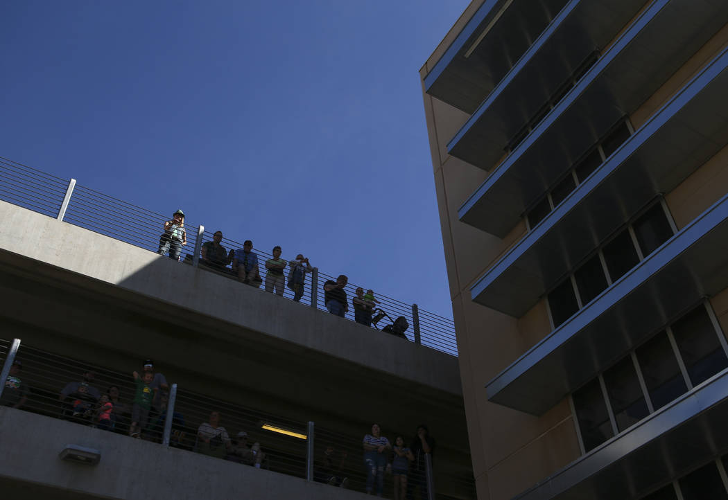 People watch from a parking garage during the St. Patrick's Day parade in Henderson on Saturday, March 11, 2017. (Chase Stevens/Las Vegas Review-Journal) @csstevensphoto