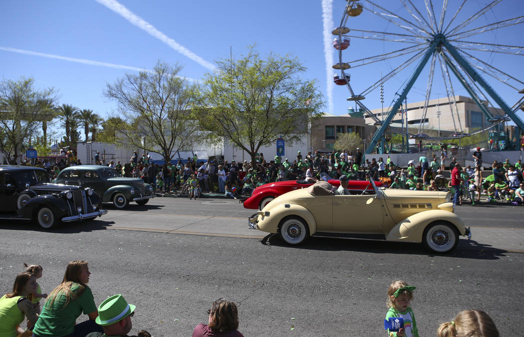 Classic cars drive down Water Street during the St. Patrick's Day parade in Henderson on Saturday, March 11, 2017. (Chase Stevens/Las Vegas Review-Journal) @csstevensphoto
