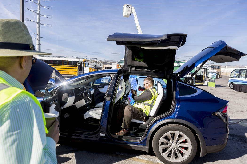 Daniel Fazekas, senior regional planner of Southern Nevada Strong, sits in a Model X Tesla SUV crossover at the Regional Transportation Commission of Southern Nevada Training Center, Wednesday, Ma ...