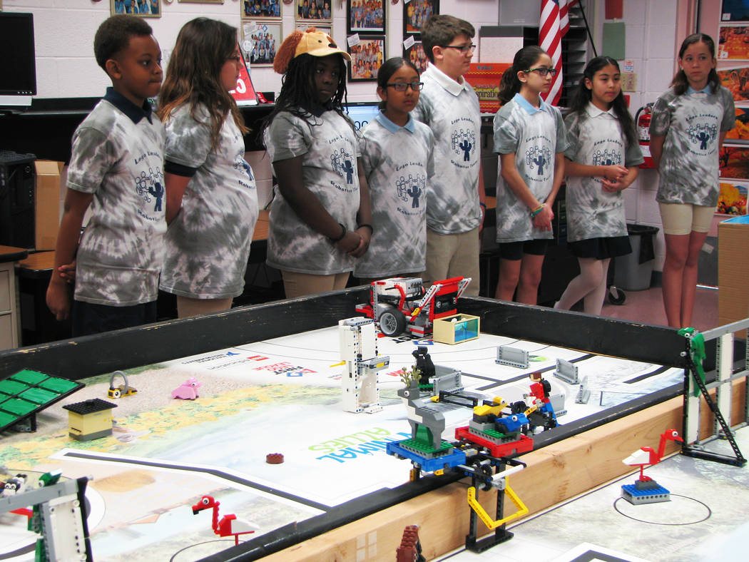Members of the Jo Mackey Academy of Leadership and Global Communication through Technology Lego Leaders team practice a presentation about their research project on a proposed pet GPS on March 9,  ...