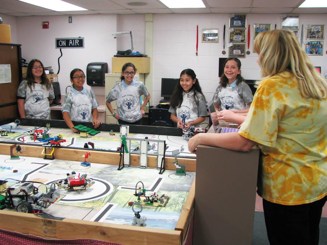 Coach Rachel Kuntz talks with members of the Jo Mackey Academy of Leadership and Global Communication through Technology Lego Leaders team on March 9, 2017. Kuntz has led the First Lego League Sou ...