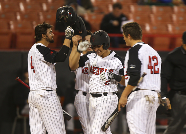 Bishop Gorman product Justin Jones, center, shown in February, went 4-for-5 with a second-inning home run and a tying RBI single in the ninth Friday in UNLV's 10-9, 11-inning home win over Air For ...