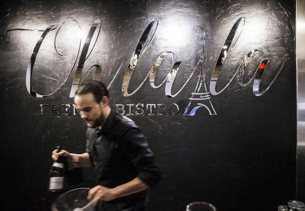 Manager Anthony DiSalvo prepares wine for a table at Ohlala French Bistro on Wednesday, March 15, 2017, in Las Vegas. (Benjamin Hager/Las Vegas Review-Journal) @benjaminhphoto