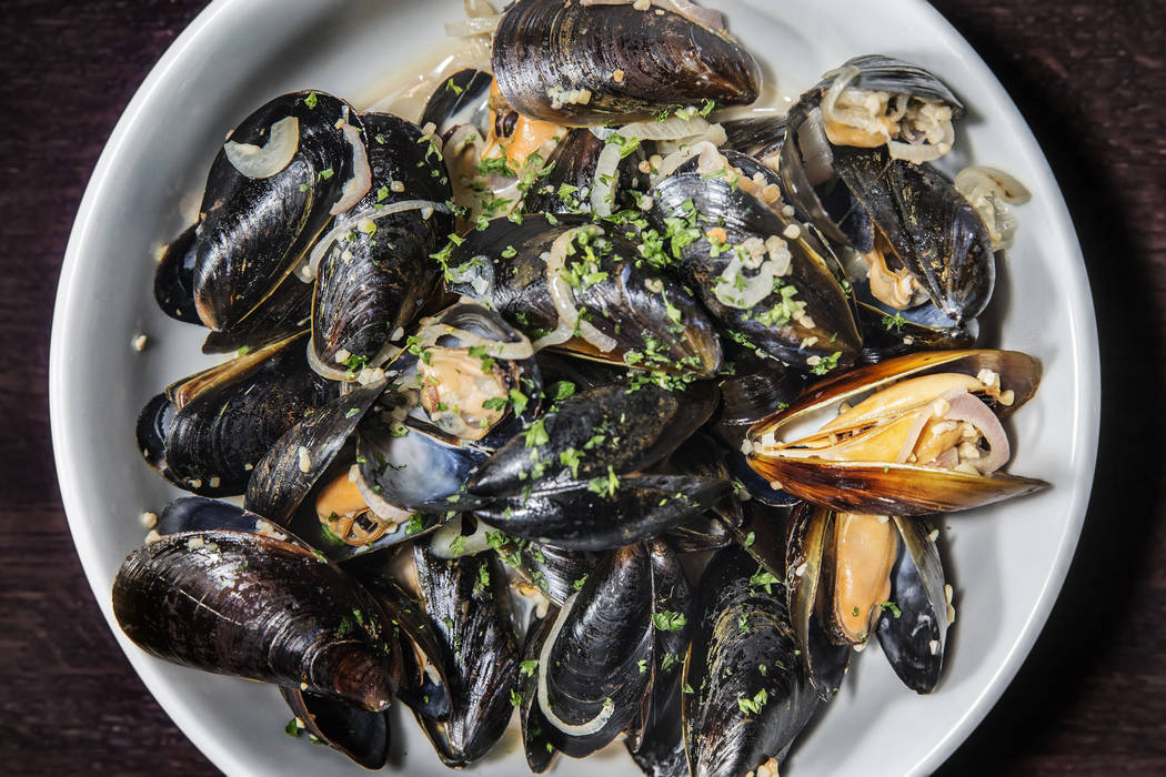 The moules mariniere, right, at Ohlala French Bistro on Wednesday, March 15, 2017, in Las Vegas. (Benjamin Hager/Las Vegas Review-Journal) @benjaminhphoto