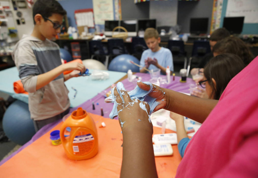 Fifth graders make a paste and other items for sale in a Claude & Stella Parson's Elementary School classroom on Friday, March 10, 2017, in Las Vegas. Students say the paste is intended to be  ...