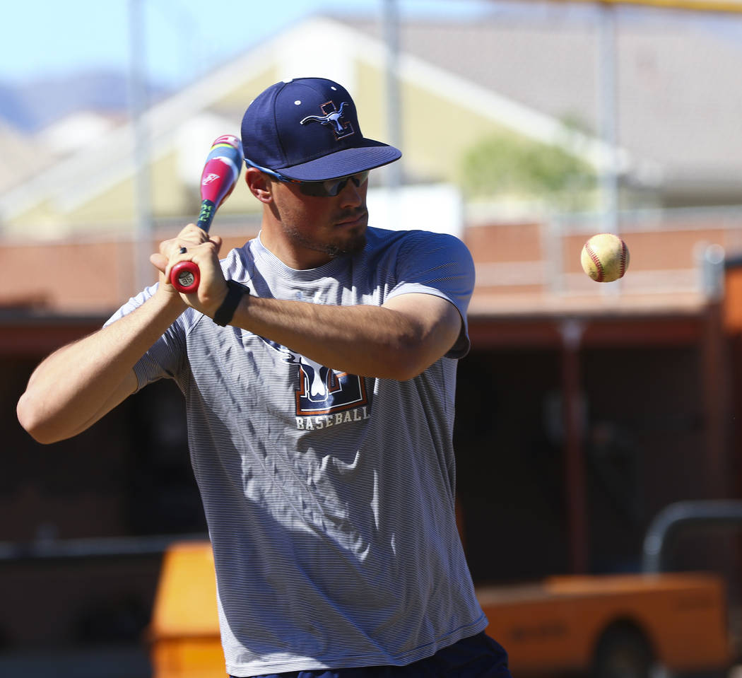 Coach of the varsity Legacy High School baseball team Joey Lauria, left, works on catching drills during practice at Legacy High School in Las Vegas on Monday, March 13, 2017. (Miranda Alam/Las Ve ...
