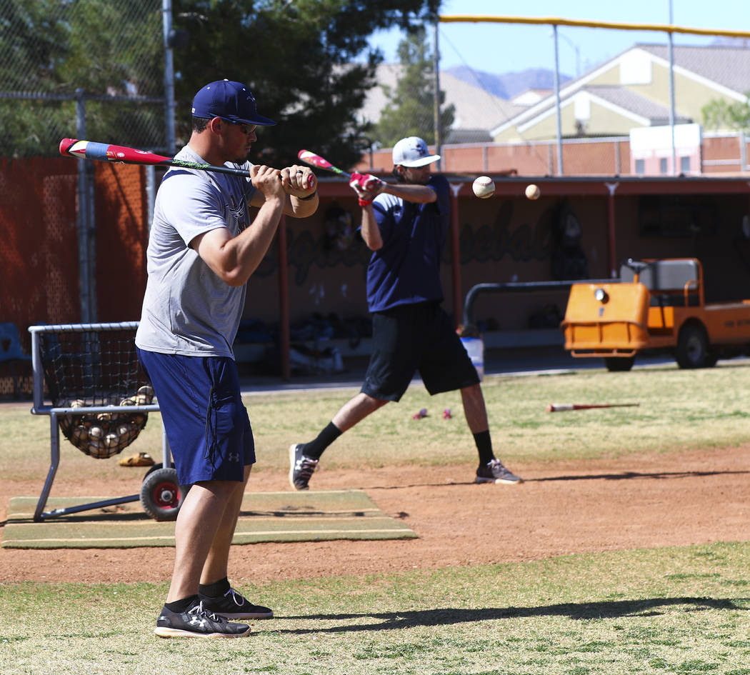 Coach of the varsity Legacy High School baseball team Joey Lauria, left, with varsity pitching coach Brayden Torres during practice at Legacy High School in Las Vegas on Monday, March 13, 2017. (M ...