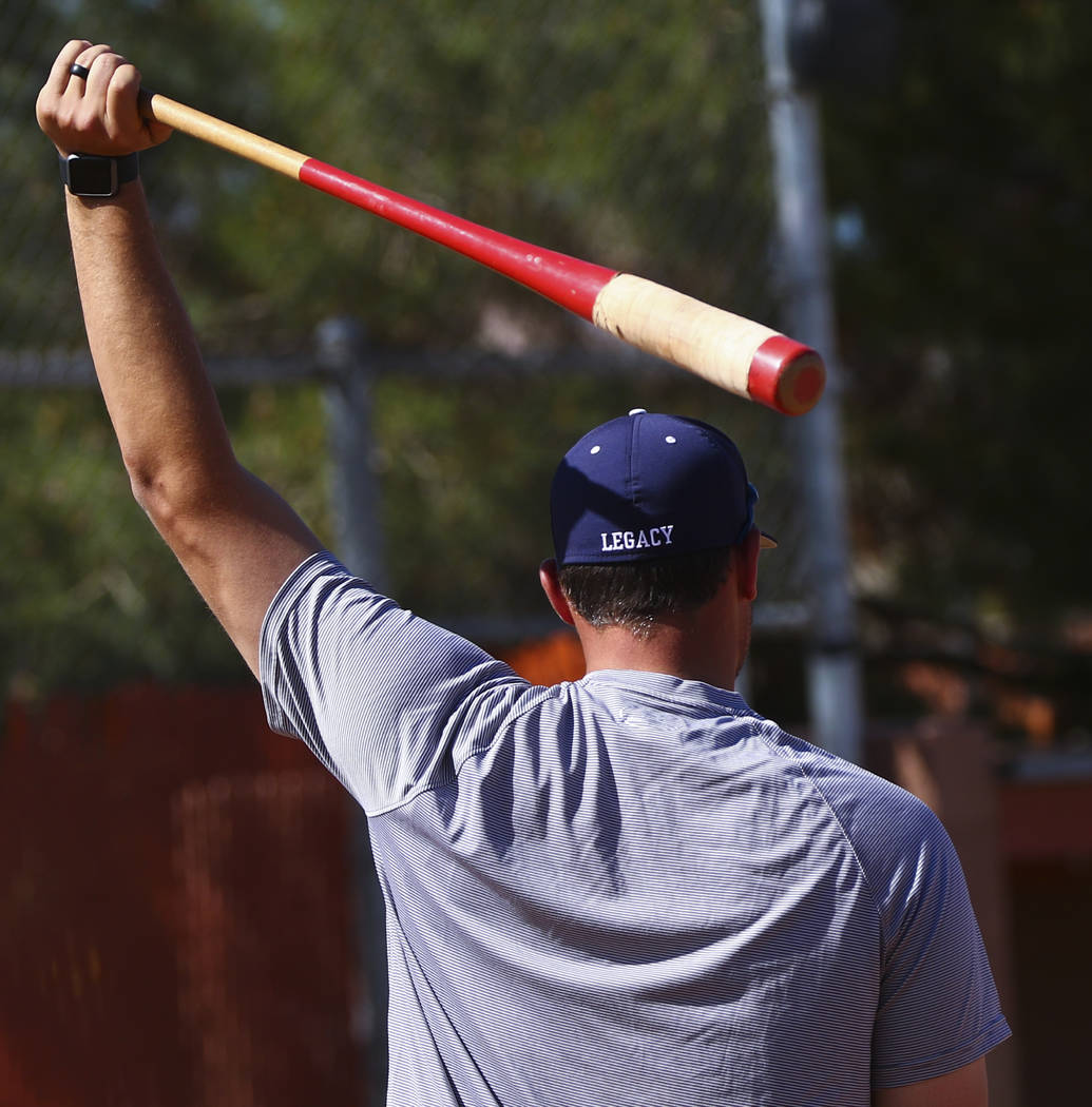 Coach of the varsity Legacy High School baseball team Joey Lauria, left, during practice at Legacy High School in Las Vegas on Monday, March 13, 2017. (Miranda Alam/Las Vegas Review-Journal) @mira ...