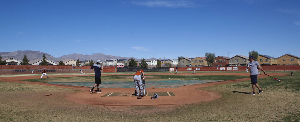 Coach of the varsity Legacy High School baseball team Joey Lauria, right, with varsity pitching coach Brayden Torres, left, during practice at Legacy High School in Las Vegas on Monday, March 13,  ...