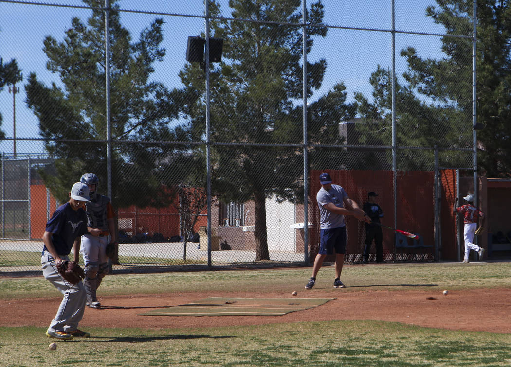 Coach of the varsity Legacy High School baseball team Joey Lauria, center, with varsity pitching coach Brayden Torres during practice at Legacy High School in Las Vegas on Monday, March 13, 2017.  ...
