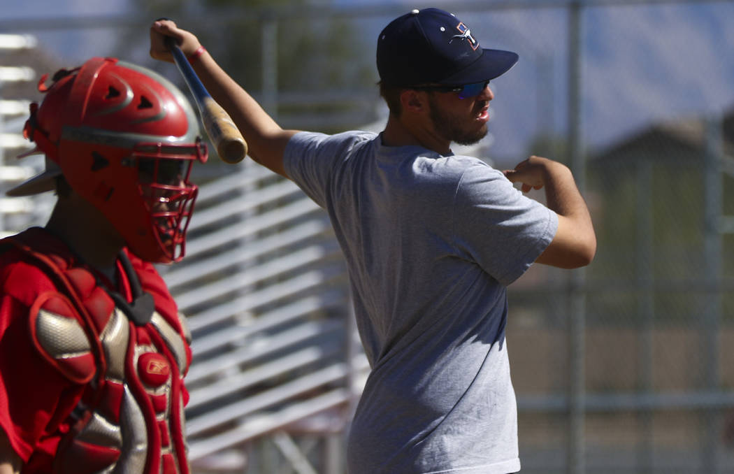 Coach of the junior varsity Legacy High School baseball team Nick Lauria, right, during practice at Legacy High School in Las Vegas on Monday, March 13, 2017. (Miranda Alam/Las Vegas Review-Journa ...