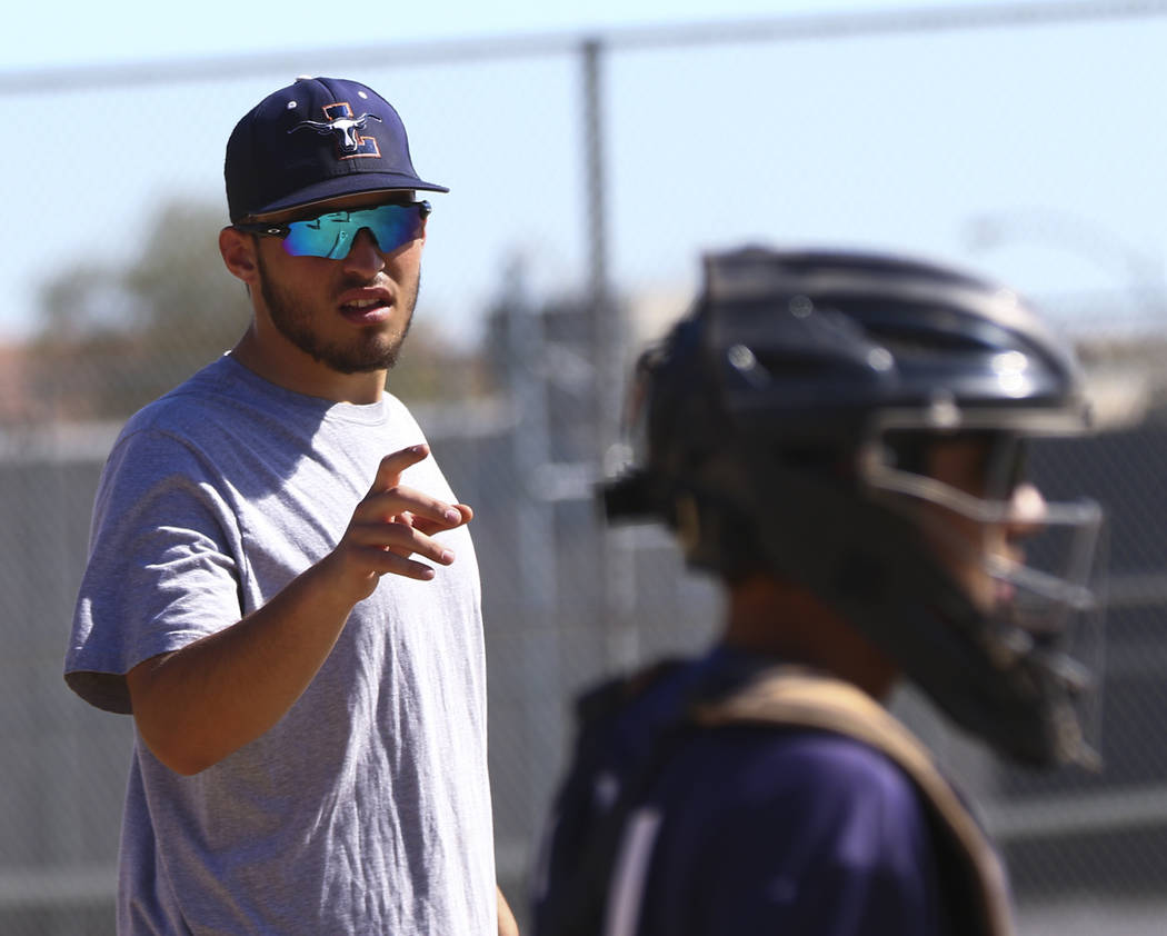 Coach of the junior varsity Legacy High School baseball team Nick Lauria, left, during practice at Legacy High School in Las Vegas on Monday, March 13, 2017. (Miranda Alam/Las Vegas Review-Journal ...