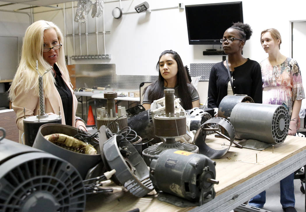 Tanya Burtis, business development manager, left, leads a tour as Joanna Briones, second left, Ruth Daniel, and Miriam Thomas look on during a Job Shadowing Day at the Associated Builders and Cont ...