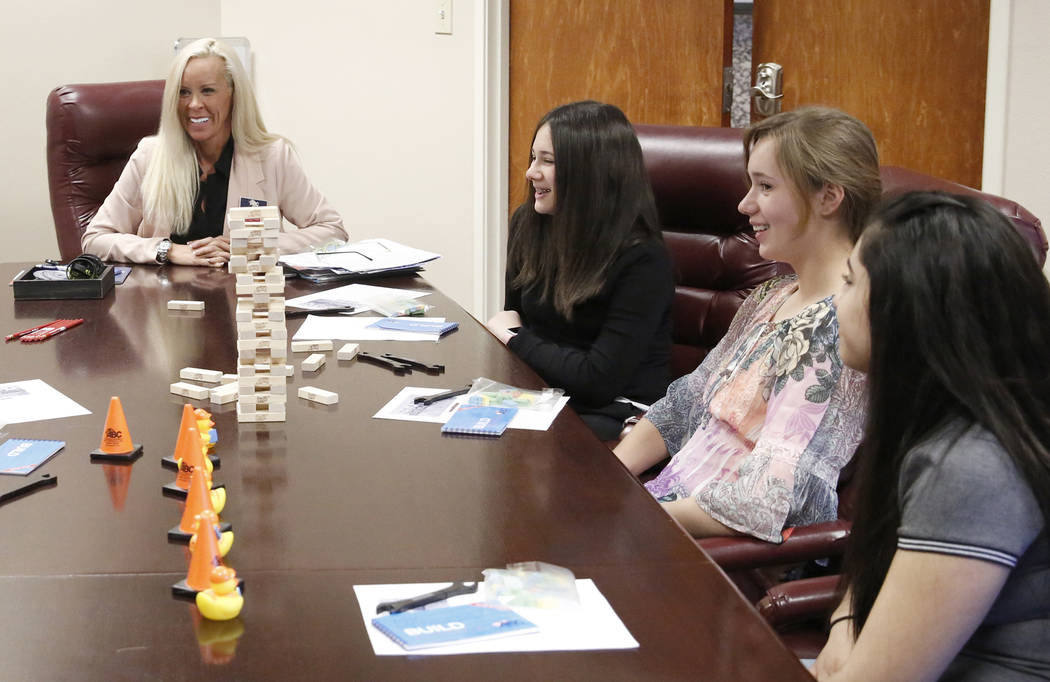 Tanya Burtis, left, business development manager, Lauren Feldman, Miriam Thomas, and Joanna Briones, right, attend a Job Shadowing Day meeting at the Associated Builders and Contractors building T ...