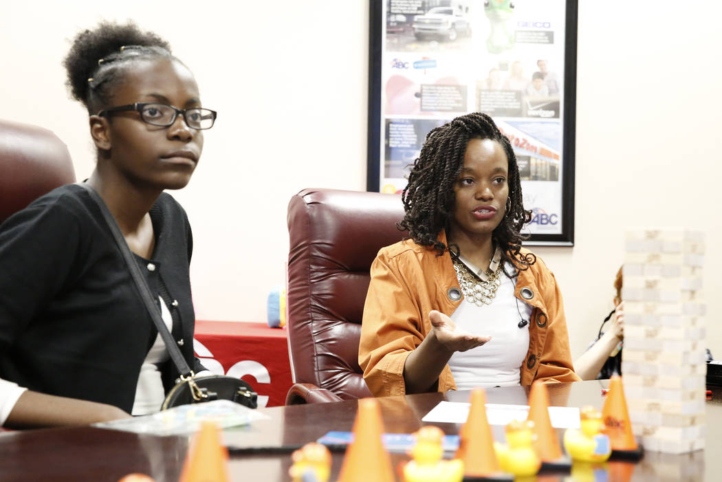 Ruth Daniel, left, listens as Tiesha Moore, G3 electrical technologies office manager, talks about the opportunity to venture and see women at work in construction-related fields during a Job Shad ...