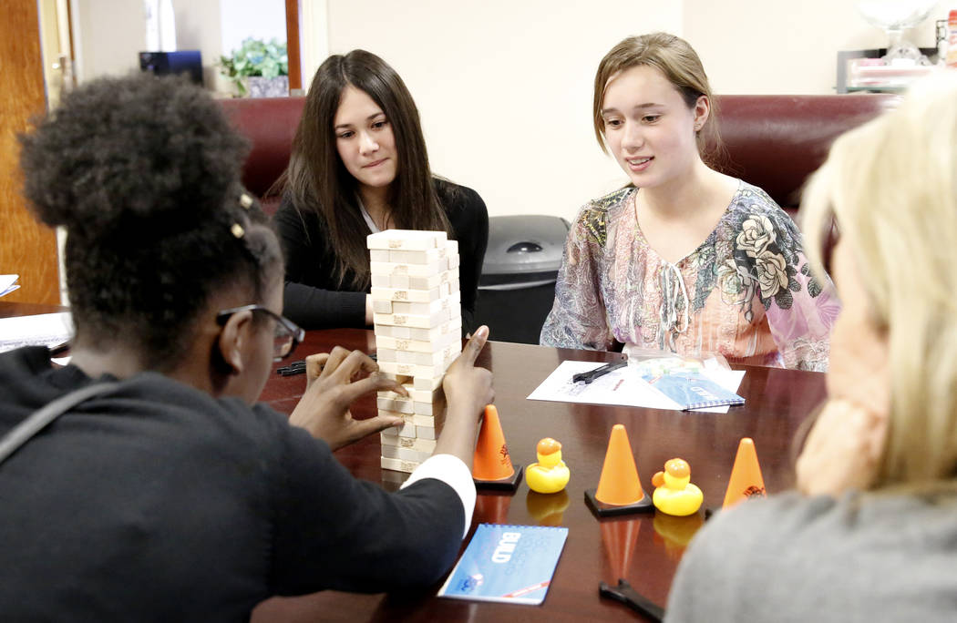Ruth Daniel, left, plays Jenga as Lauren Feldman, center, and Miriam Thomas look on during a Job Shadowing Day meet at the Associated Builders and Contractors building Thursday, March 9, 2017, in  ...