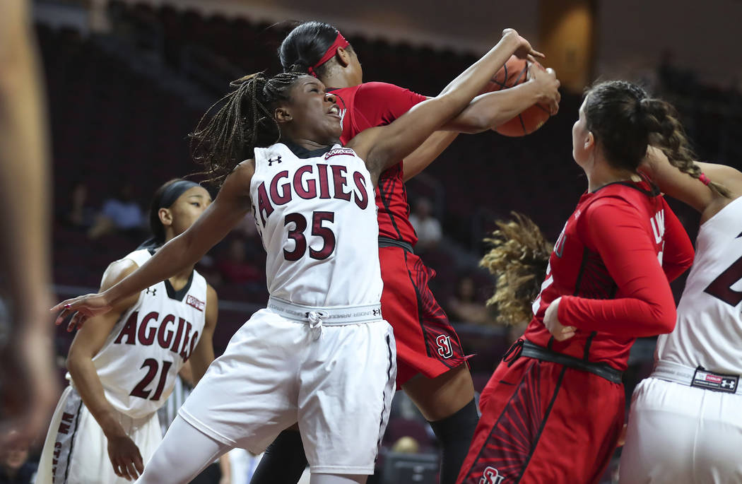 New Mexico State guard Moriah Mack (35) reaches back for a rebound over the back of Seattle University guard Alexis Montgomery during the second half of NCAA college basketball game in the final o ...