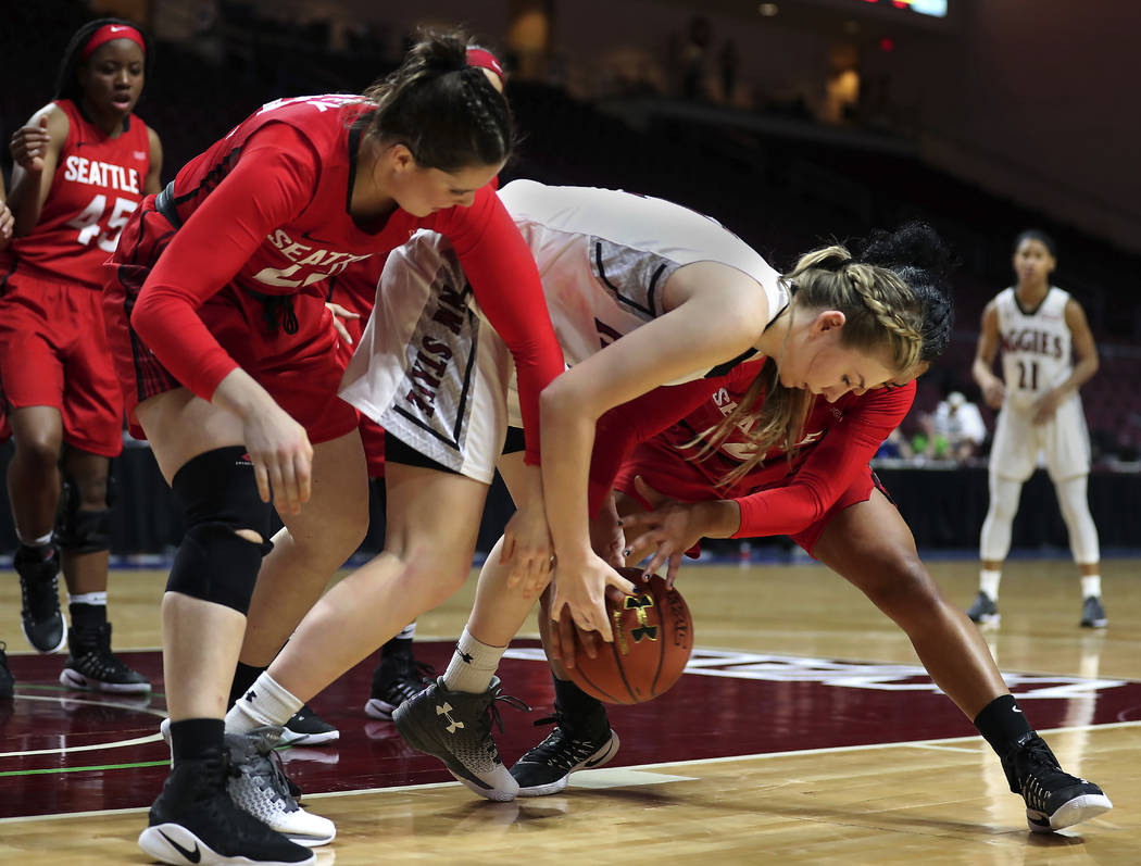 New Mexico State guard Brooke Salas (2) battles for a loose ball with Seattle defenders during the second half of NCAA college basketball game in the final of the Western Athletic Conference tourn ...