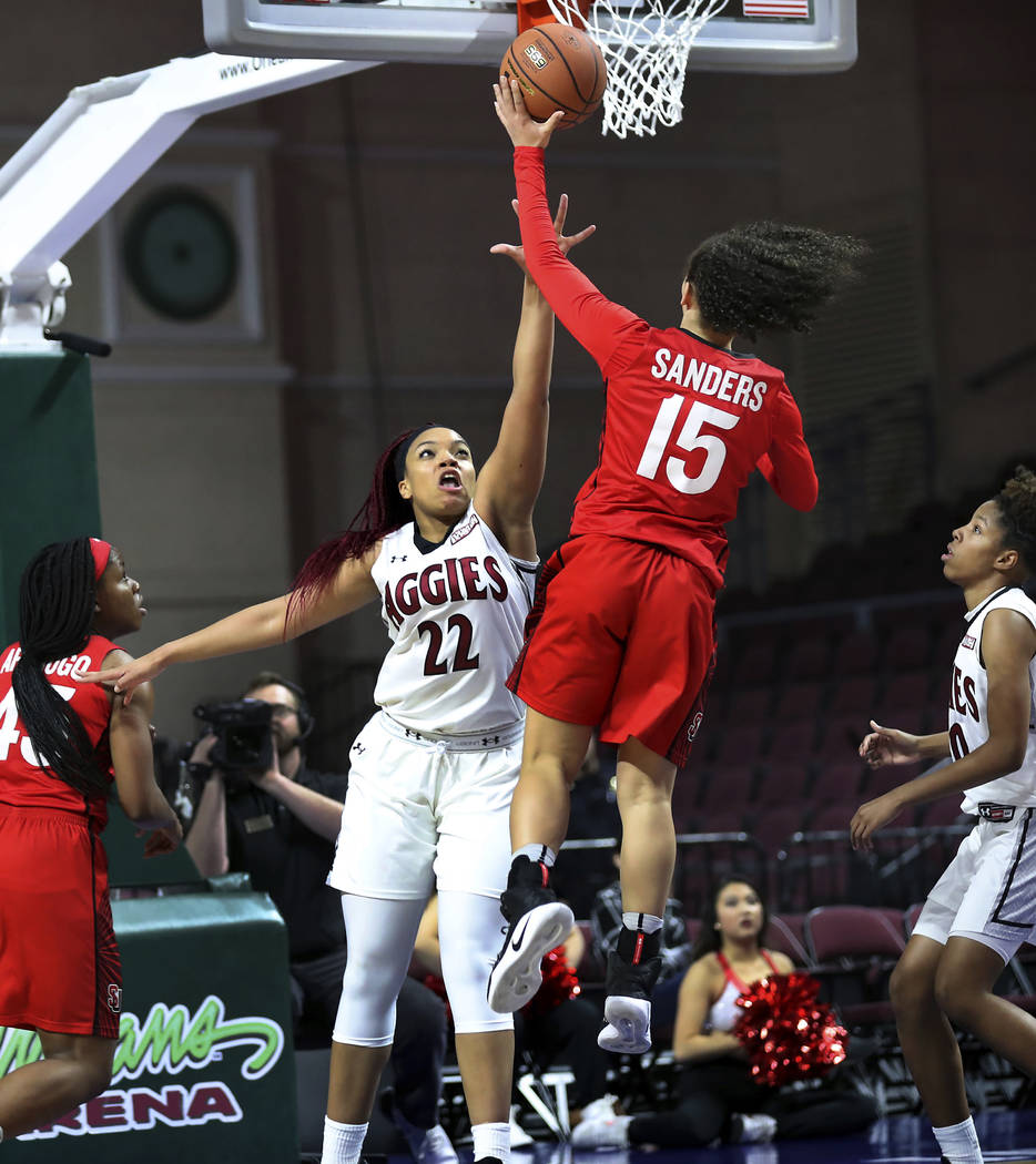 New Mexico State forward Tyler Ellis (22) reaches out to defend the basket from Seattle University guard Kamira Sanders (15) during the second half of NCAA college basketball game in the final of  ...