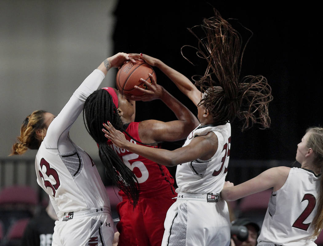 Seattle University guard Wilma Afunugo (45) has the ball stopped by New Mexico State forward Jeneva Toilolo (33) and guard Moriah Mack (35) during the second half of NCAA college basketball game i ...