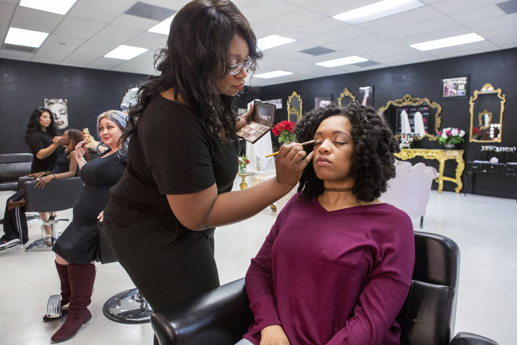Hair and makeup artist Jessyca Wardlow-Harper works on model Breyana Wardlow at Babydoll Beauty Couture a new salon catering to plus-sized women located on North Decatur Blvd. and West Lake Mead B ...
