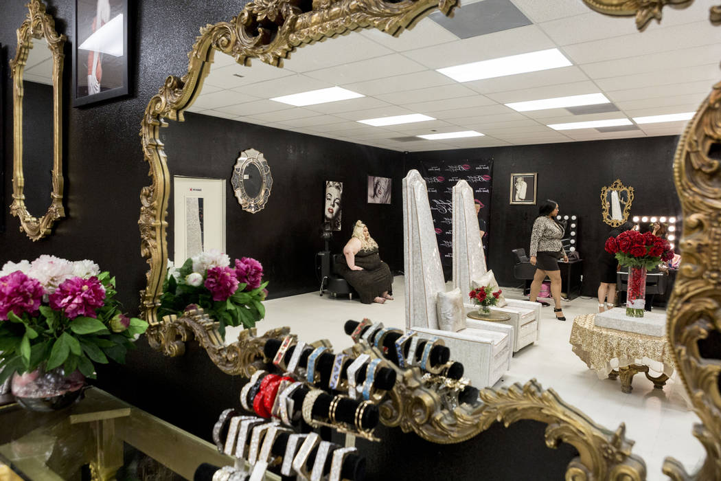Owner of Babydoll Beauty Couture Jamie Lopez, left, and Jessica Chambers, reflect in a mirror in Lopez's new salon catering to plus-sized women located on North Decatur Blvd. and West Lake Mead Bl ...
