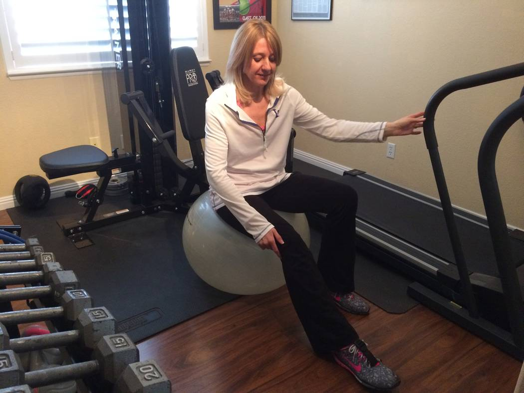 Milena Kaplan works out in her northwest home Feb. 22. Diagnosed in 2012, she was a regular at the gym but now uses a walker. The Cleveland Clinic Lou Ruvo Center for Brain Health recently put out ...