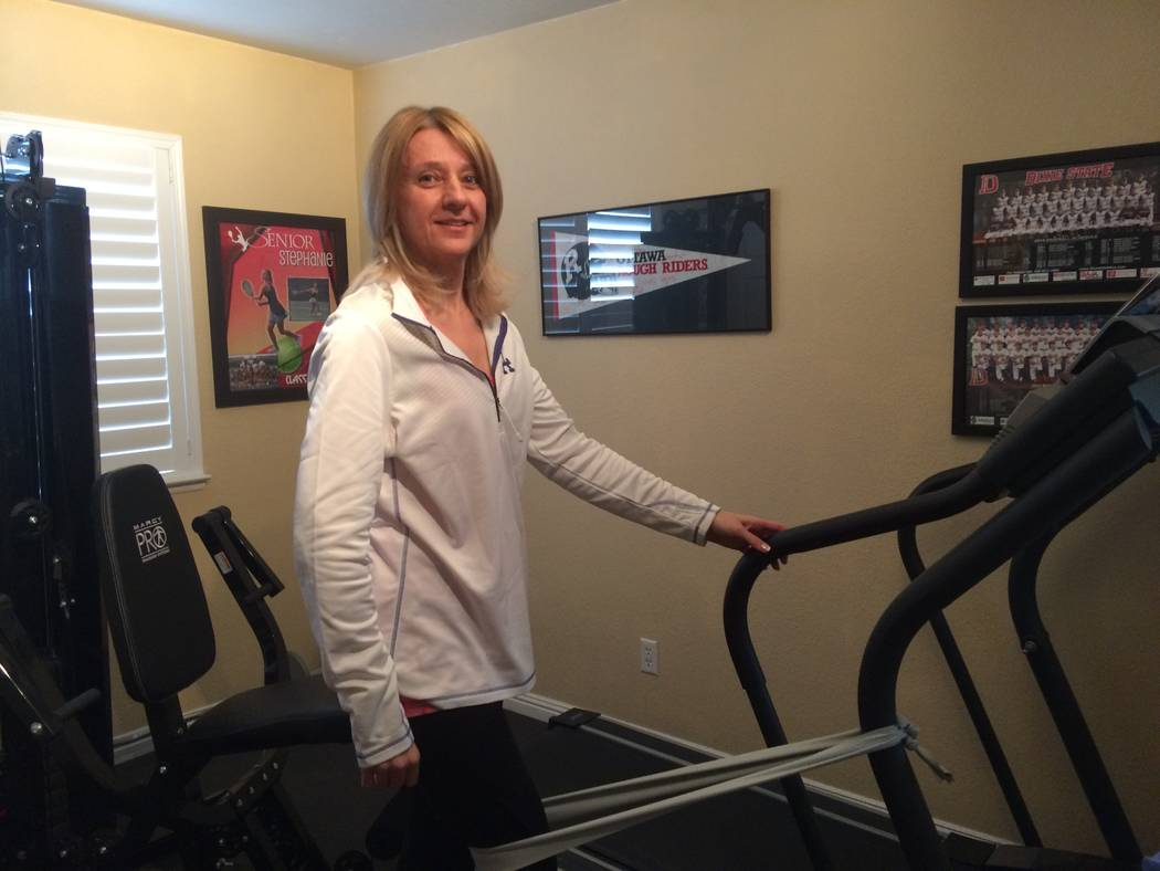 Milena Kaplan works out with stretch bands in her northwest home Feb. 22. Diagnosed in 2012, she was a regular at the gym but now uses a walker. The Cleveland Clinic Lou Ruvo Center for Brain Heal ...