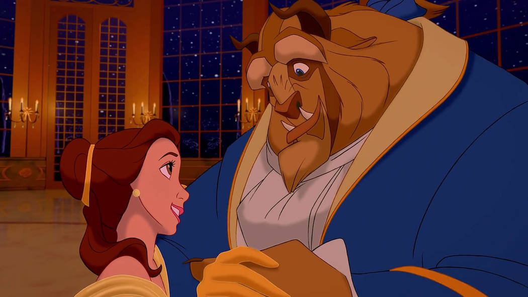 """Belle and the Beast dance in the iconic ballroom scene in Disney's animated musical """"Beauty and the Beast"""" (1991)."""