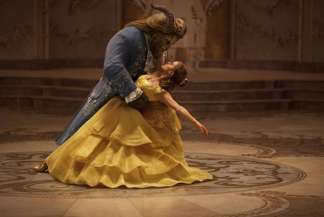 """Emma Watson stars as Belle and Dan Stevens as the Beast in Disney's """"Beauty and the Beast,"""" a live-action adaptation of the studio's animated classic directed by Bill Condon."""